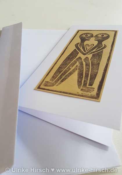 """Linoldruck-Klappkarte """"Liebende"""" (dunkelbraun auf gold)"""
